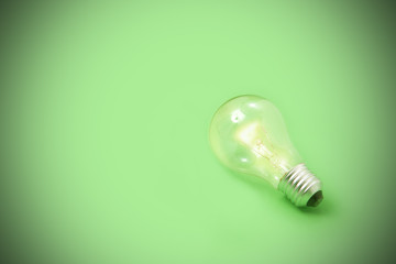 ight bulb on green background