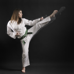 woman - master of karate performs a high kick- 01.