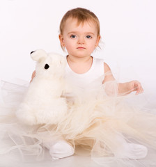 cute little baby with a toy. a large portrait of