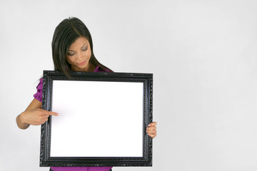 Woman pointing to empty picture frame
