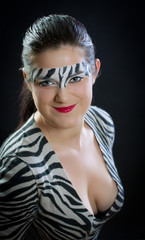 The girl with a make-up of a zebra. A carnival