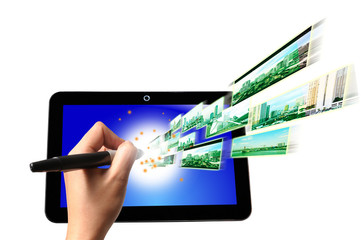 Hand of Business Man write on Touch screen of Tablet PC with Fly