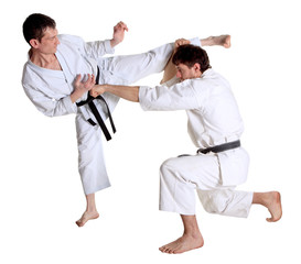 Karate. Men in a kimono with a white background