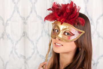 Young beautiful girl in a mask