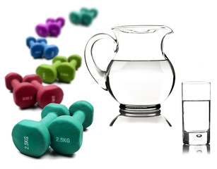 Water in a pitcher and glass with dumbbells