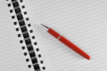 red pen and empty notebook