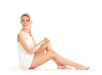 A young and fit blond on a white background