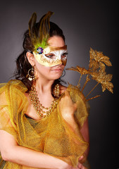 Woman  in carnival costume with mask.