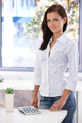 Pretty office worker smiling in bright office