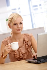 Portrait of young office worker on coffee break