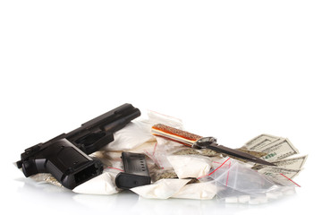 Cocaine and marijuana in packet with gun isolated on white