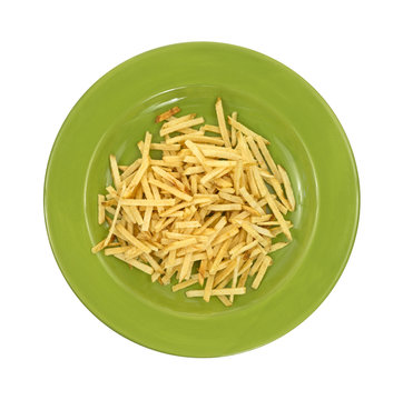 Green plate with shoestring potatoes