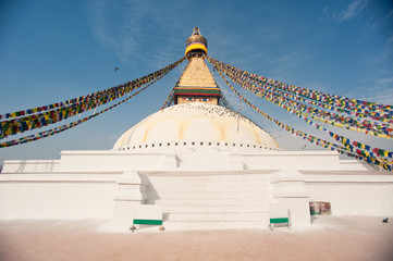Prayer flags fluttering from the largest stupa in Nepal,