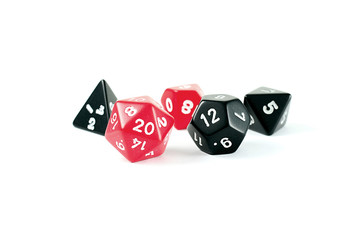 Photo of red and black multi-sided dice, on white