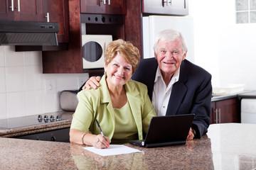 happy senior couple checking retirement investment