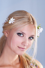 Portrait of smiling blonde woman with flowers in her hair