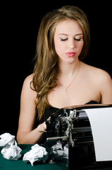 The beautiful girl at a typewriter. A retro style