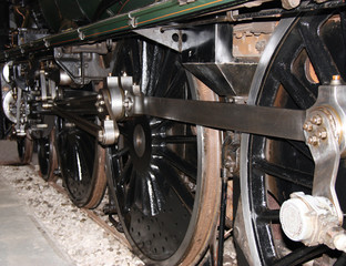The Wheels of a Large Powerful Steam Train Engine.