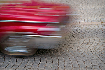 red car in blurred motion