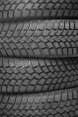 Background of four car wheel winter tires
