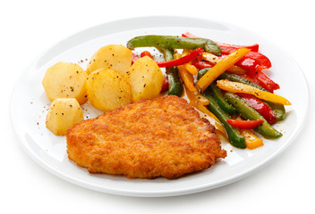 Pork chop, roasted potatoes and vegetables
