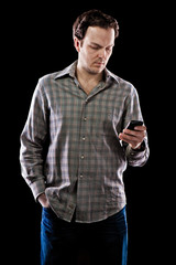 Man texting on smartphone