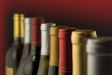 Wall Mural - Wine bottle necks with limited depth of field