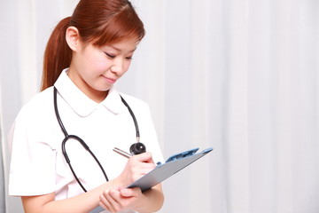 young japanese nurse with medical chart