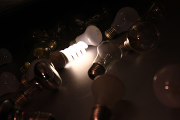 a bright light bulb among others