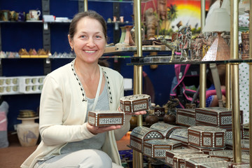 Woman chooses egyptian souvenir