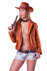 Sexy blond Cowgirl blowing a gun isolated
