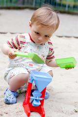 a little boy in the sandbox