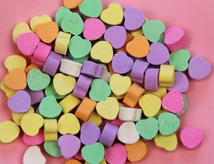 Candy hearts on pink