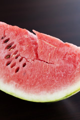 watermelon lying on a wooden table