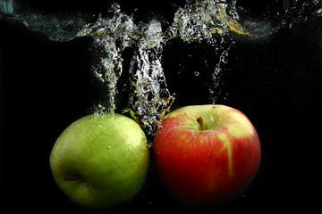 Green and red apples isolated on a black background