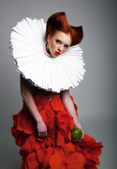Romantic portrait of redhair woman in white jabot and red dress
