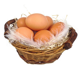 eggs in a wicker basket isolated on white background