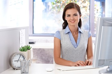 Attractive girl using computer in office