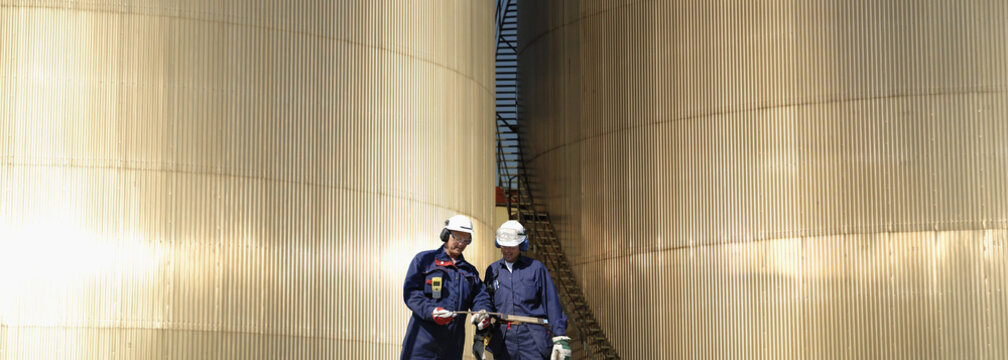 fuel-storage towers and oil-workers