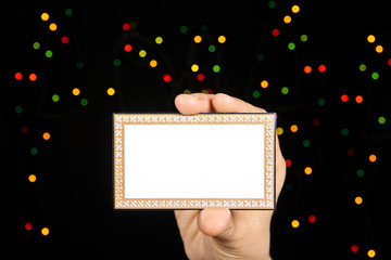 Card with many-colored sparkles on hand.