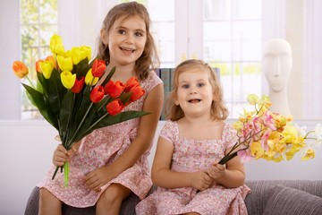 Little girls at mother's day smiling
