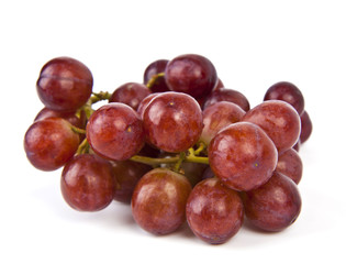Red grapes on white background.