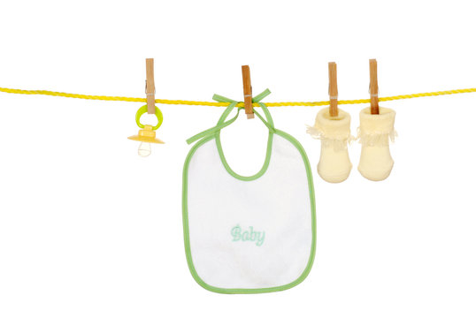 Isolated baby bib socks on a clothes line