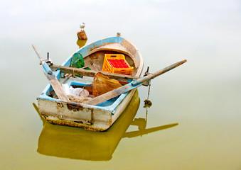 Old wooden fishing boat in the lake Orestiada in Greece