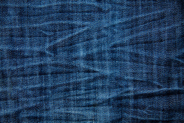 Blue wrinkled denim jeans texture, background