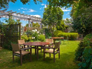 dining table set in lush garden