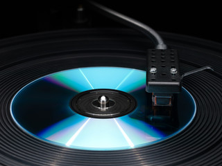 Player of vinyl disks and compact disk.