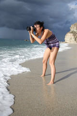 woman photographer takes photo of the beautiful seascape