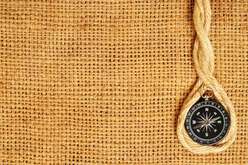 frame of compass and ropes on sack