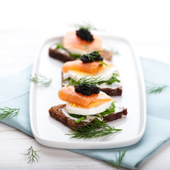 Salmon Snack with Egg and Caviar